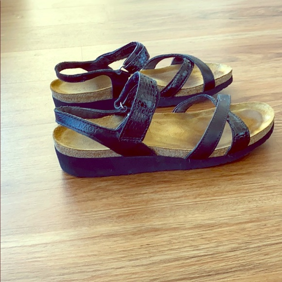 Black NAOT sandals size 9 with straps at ankle